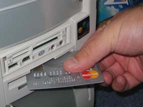 inserting credit card into computer