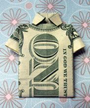 dollar bill folded into a t-shirt