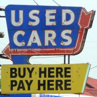 used car buy here pay here sign